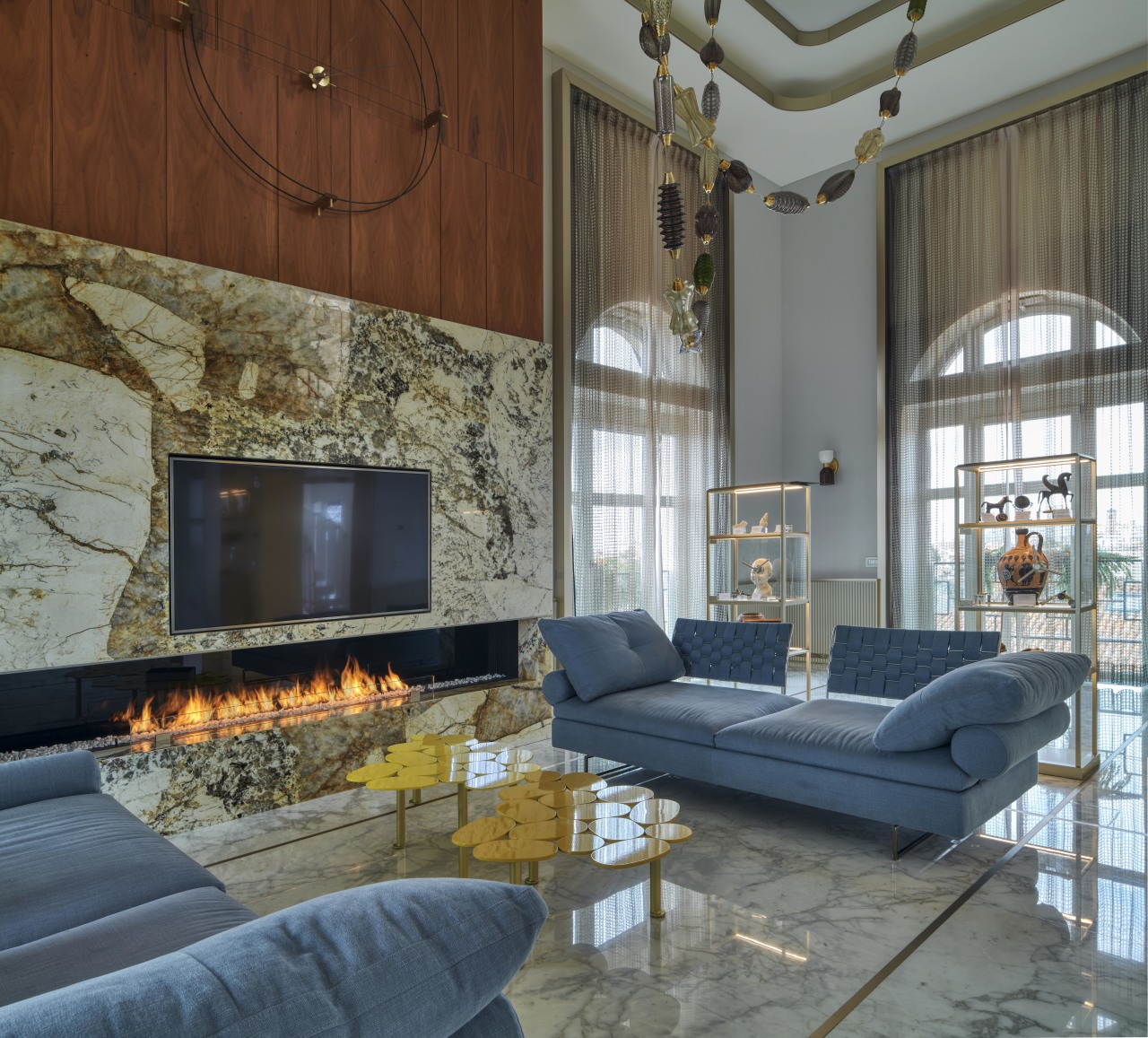 A striking bioethanol marble fireplace warms the room