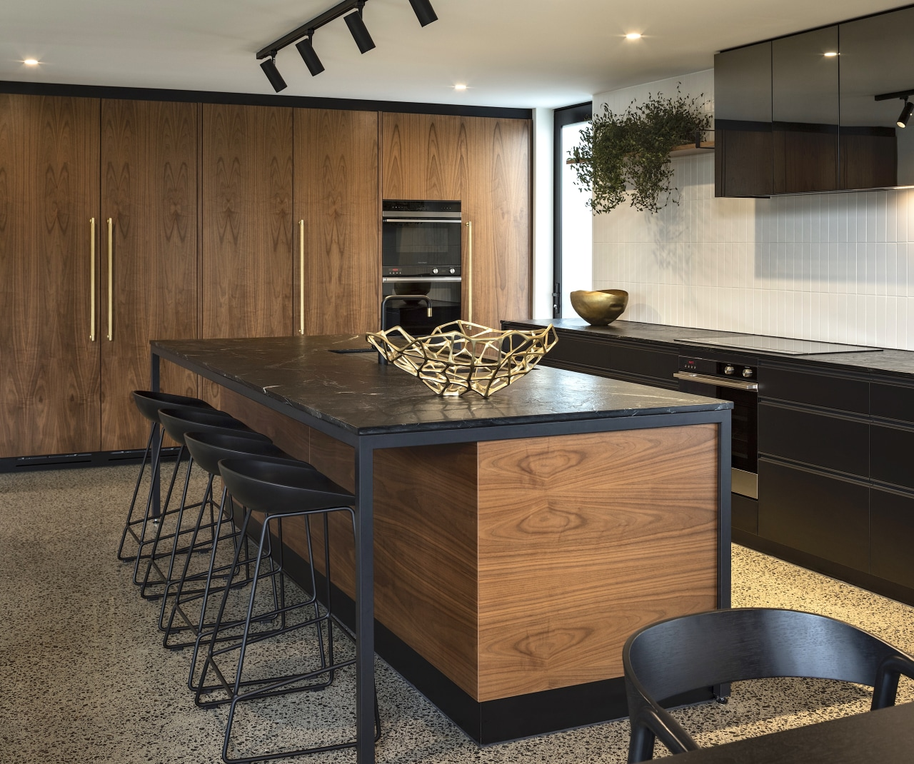 American walnut veneer meets hard-wearing Meltica surfaces in