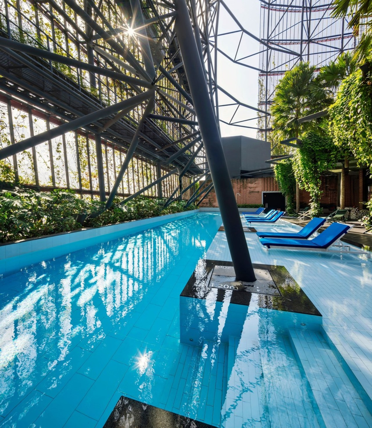 The entire building has the feel of a leisure, leisure centre, property, real estate, recreation, resort, resort town, swimming pool, water, water park, teal