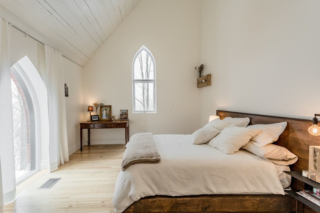The design combines two very important criteria – architecture, attic, bed, bed frame, bed sheet, bedding, bedroom, building, ceiling, comfort, daylighting, estate, floor, flooring, furniture, hardwood, home, house, interior design, mattress, property, real estate, room, suite, wall, wood, wood flooring, gray