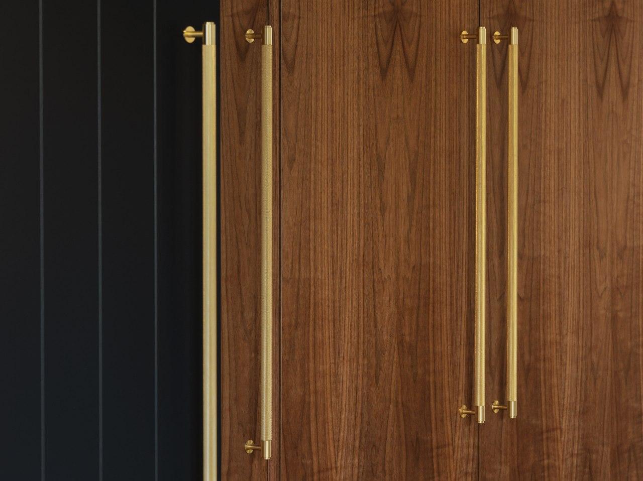 American walnut veneer meets a weatherboard-look barn door