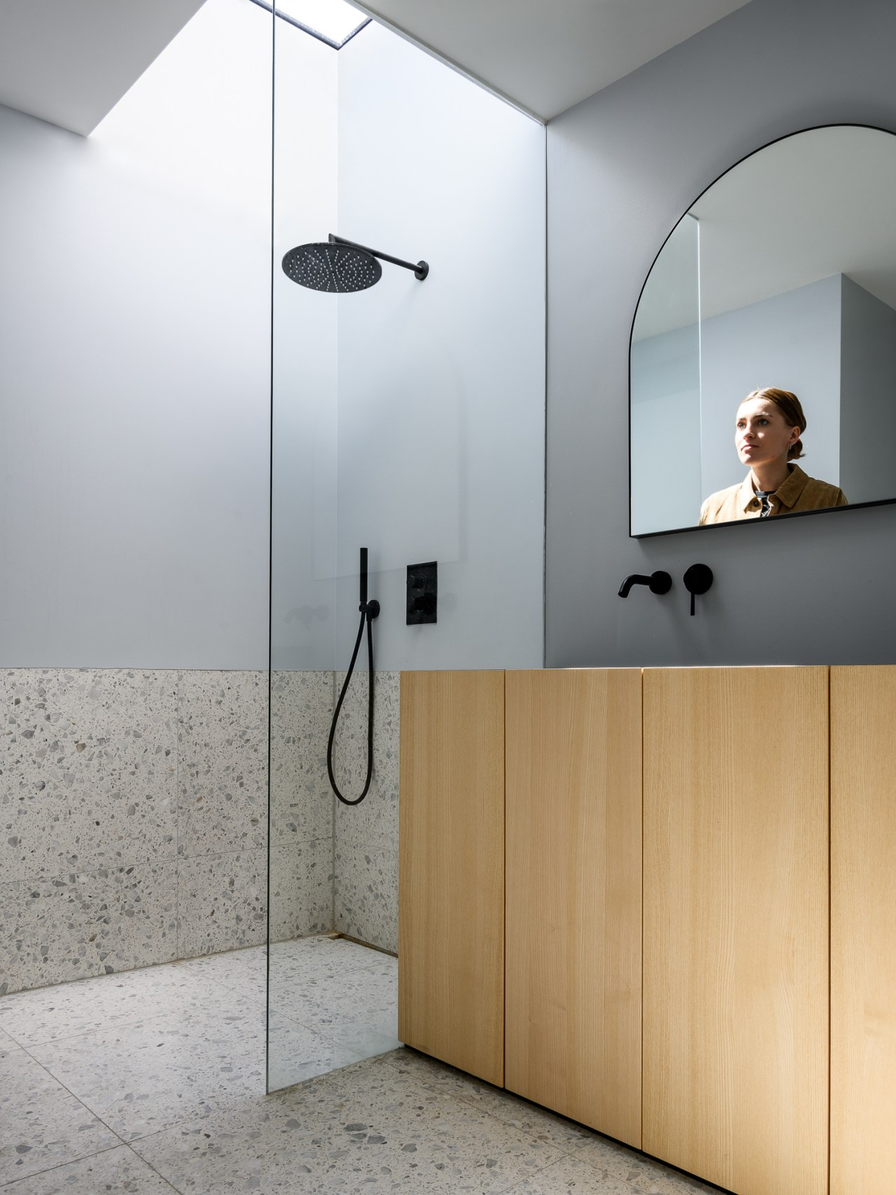 A skylight is positioned directly over the shower