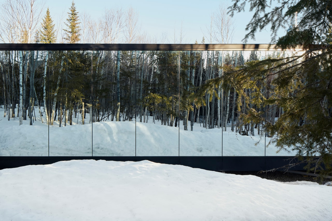 As the seasons change, the mirrored facades on