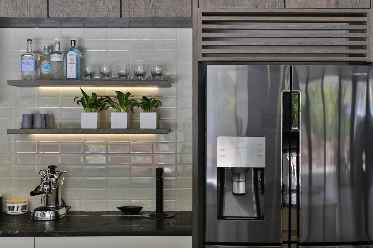 Under-lit display shelving adds to the kitchen's visual