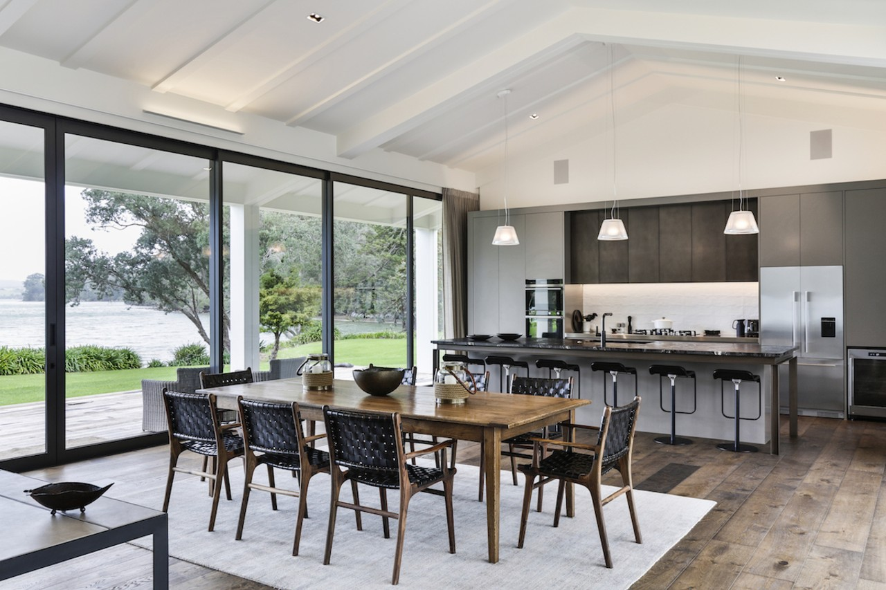The owners of this architecturally designed house wanted dining room, house, interior design, real estate, table, gray