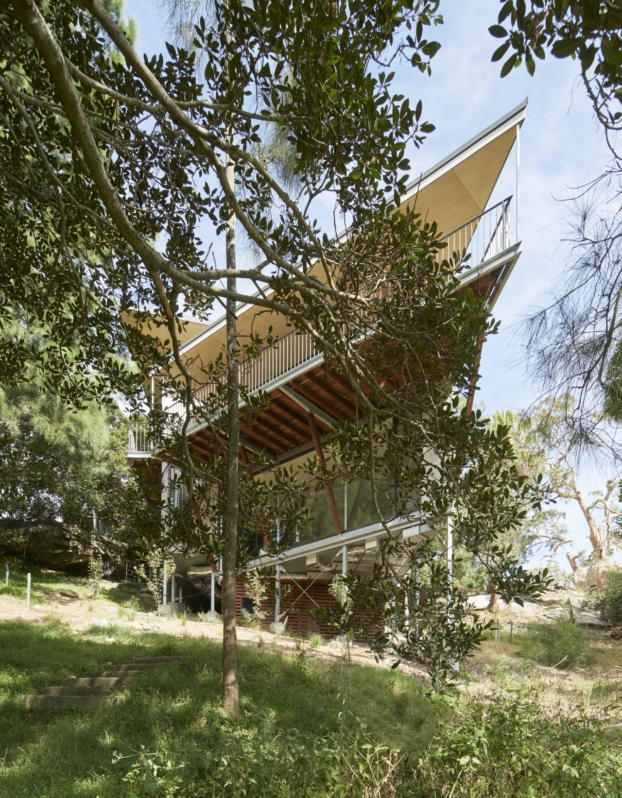 Inside, this home's envelope gradually opens up to