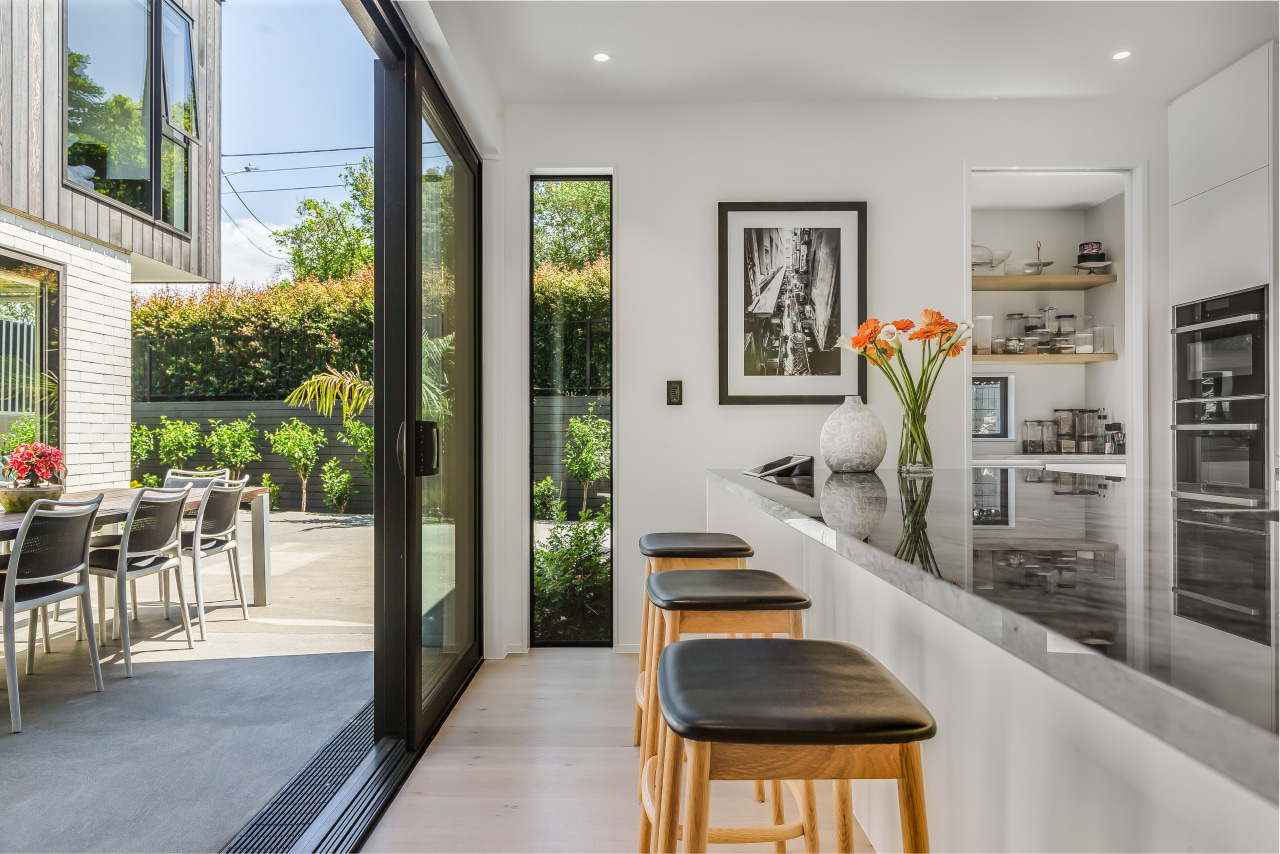 The kitchen opens up to the home's central