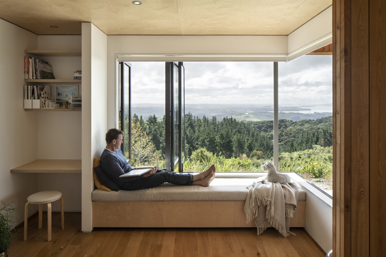 Here bench seating provides storage while bi-fold windows