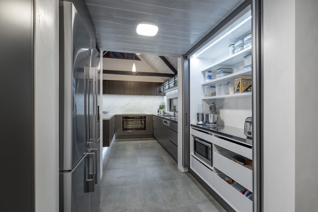 The existing pantry was re-designed with bifold pocket