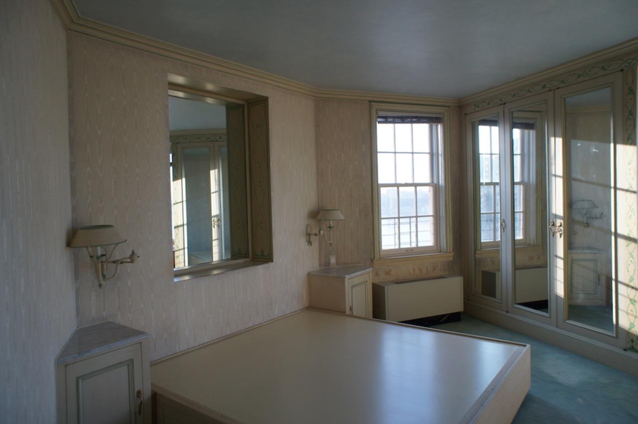 Corner bedroom before.