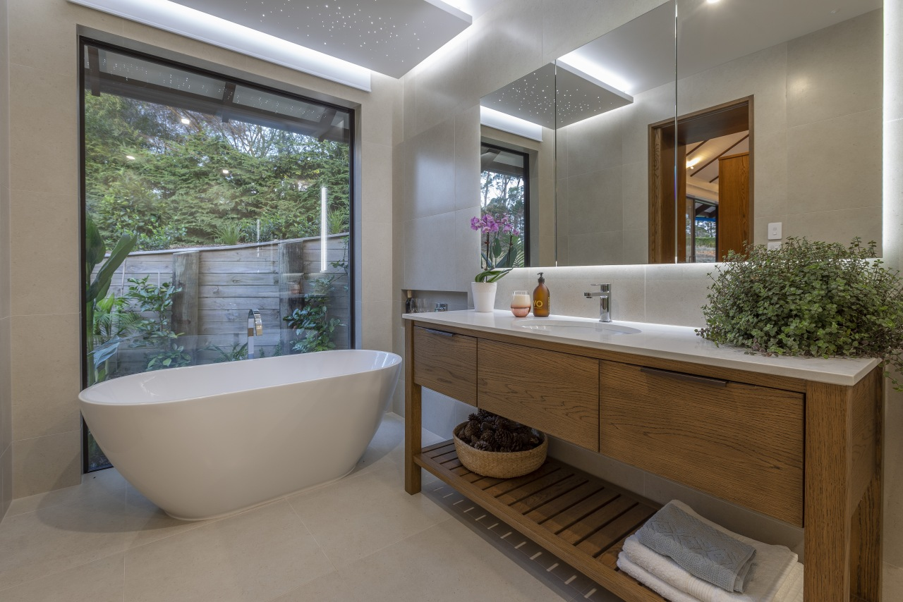 The soft lines of a freestanding tub and architecture, bathroom, bathtub, building, ceiling, estate, floor, furniture, home, house, interior design, plumbing fixture, property, real estate, room, tile, gray