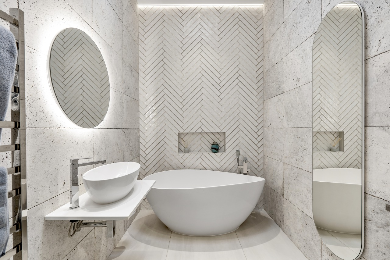 A wall of white herringbone tiles were selected