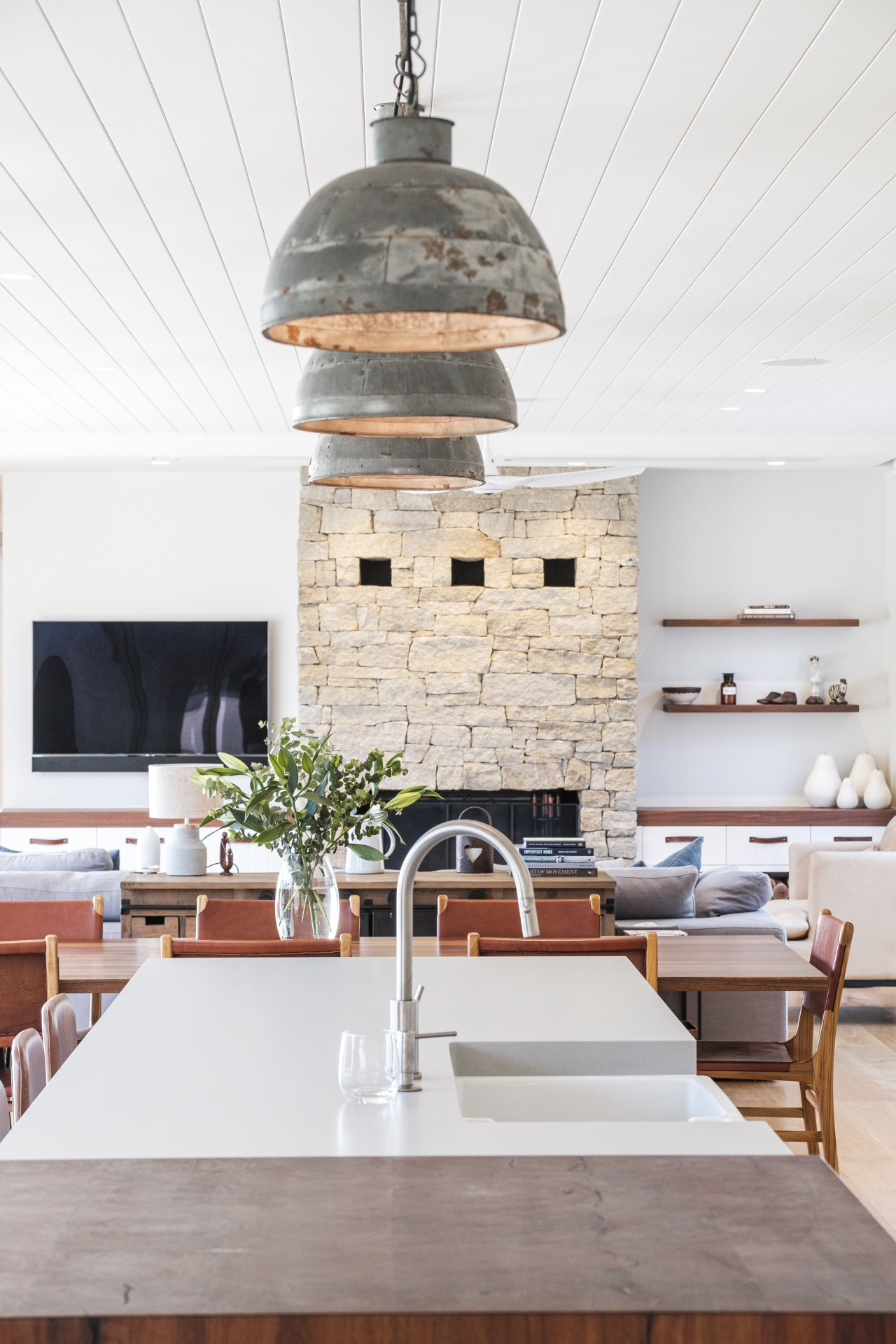The kitchen features recycled timber elements and hints