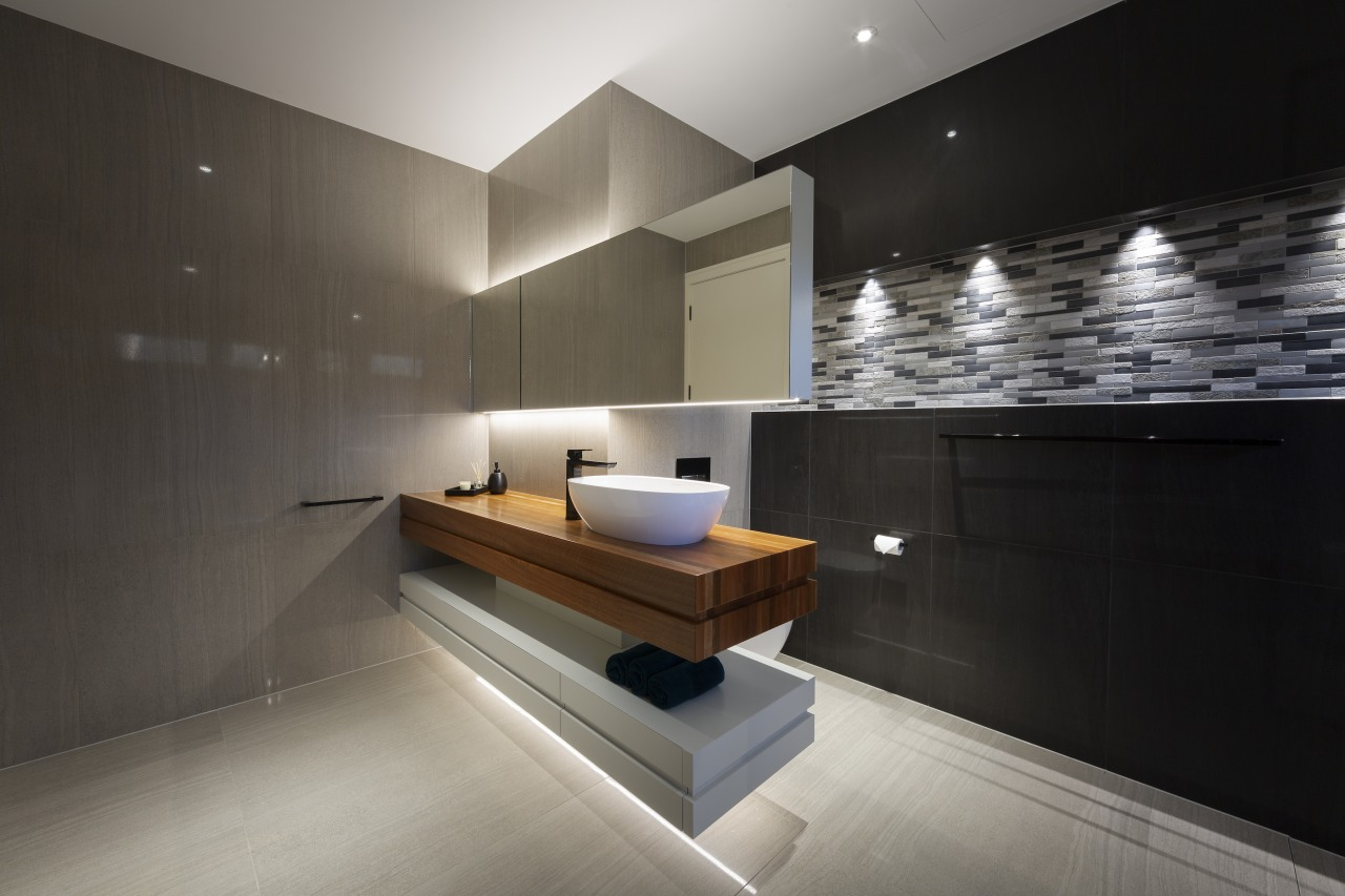 The vanity is cantilevered off a short wall