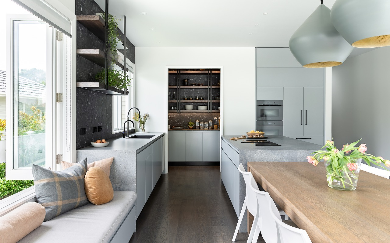 The open shelving seen in both kitchen and