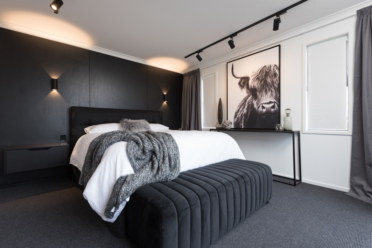 The master bedroom's black feature wall is highlighted