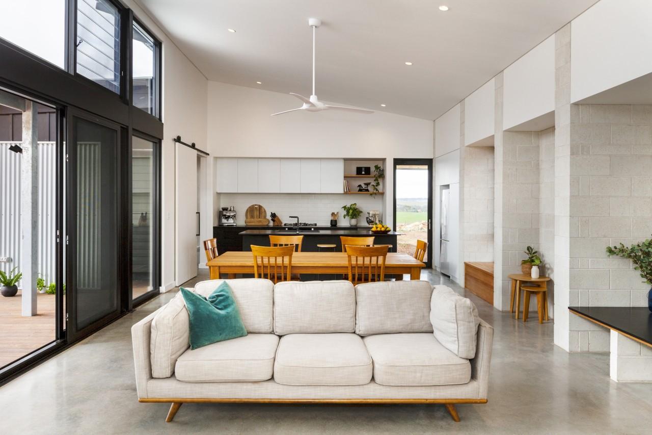 Large, glazed sliding doors provide a panorama of