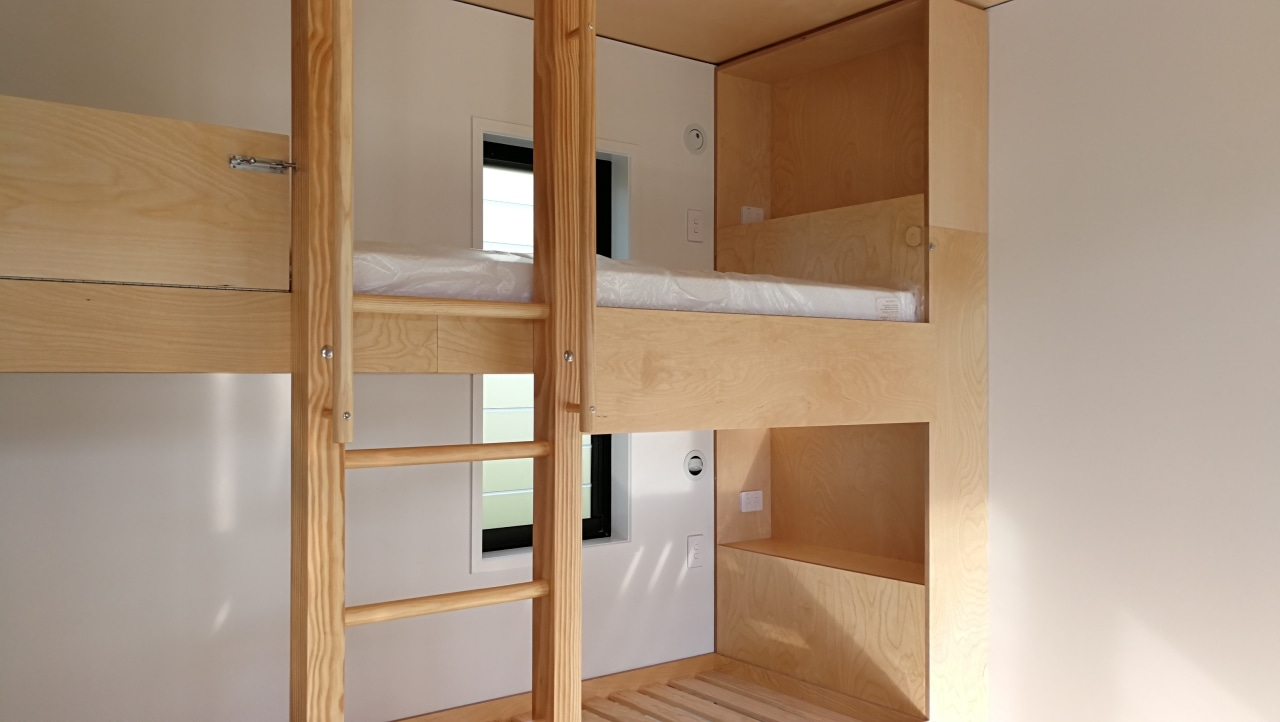 The children's bunk room also features finely finished