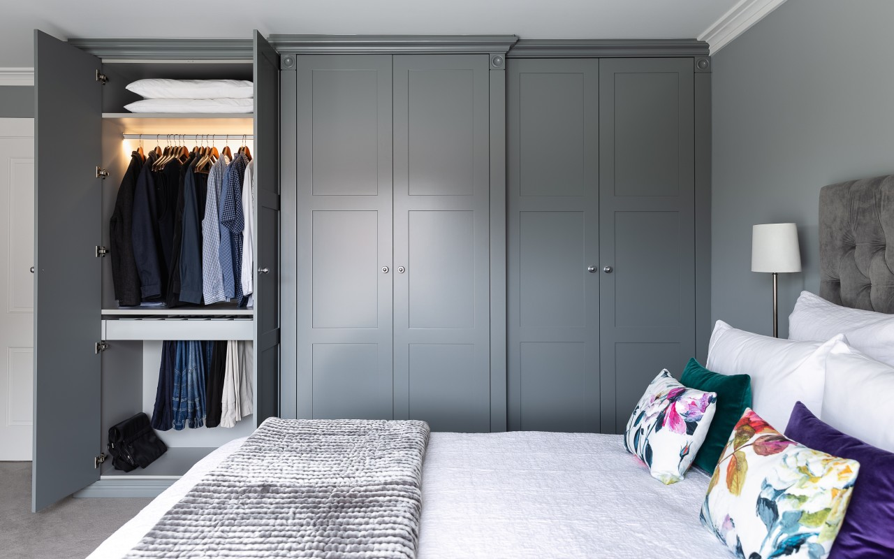 The master bedroom benefits from custom-designed, function-rich wardrobe