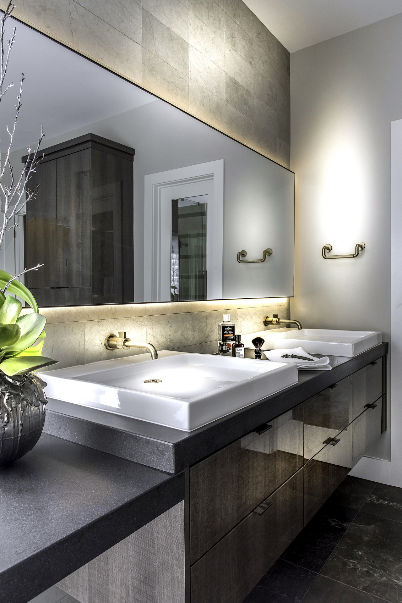 Textured tiles and a back-lit mirror add to