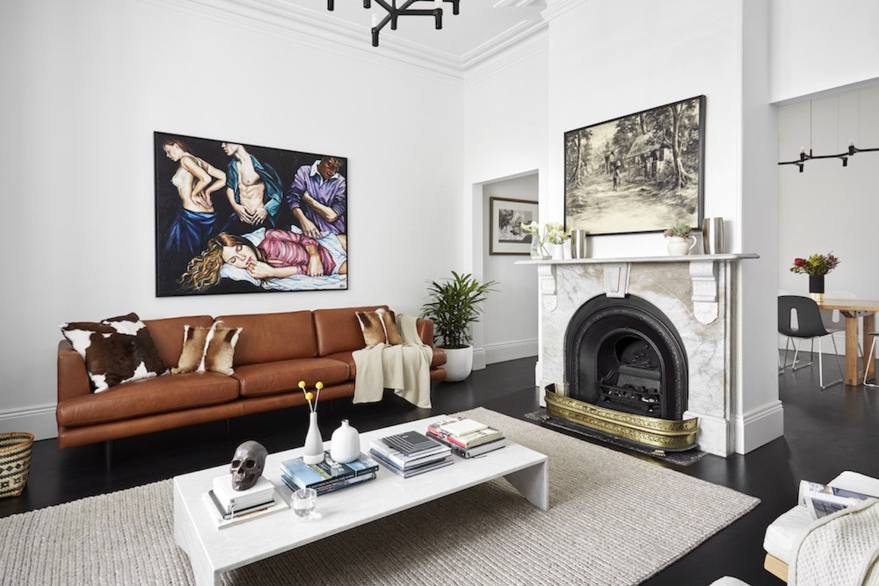 Using a large rug and placing the coffee furniture, hearth, home, interior design, living room, room, table, white