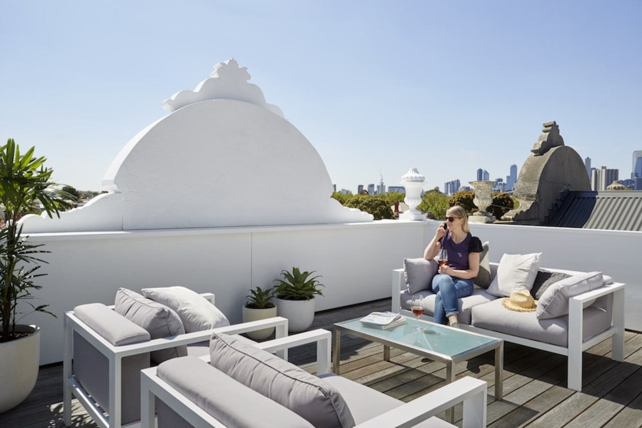 The rooftop terrace just catches a water view home, roof, sky, vacation, gray