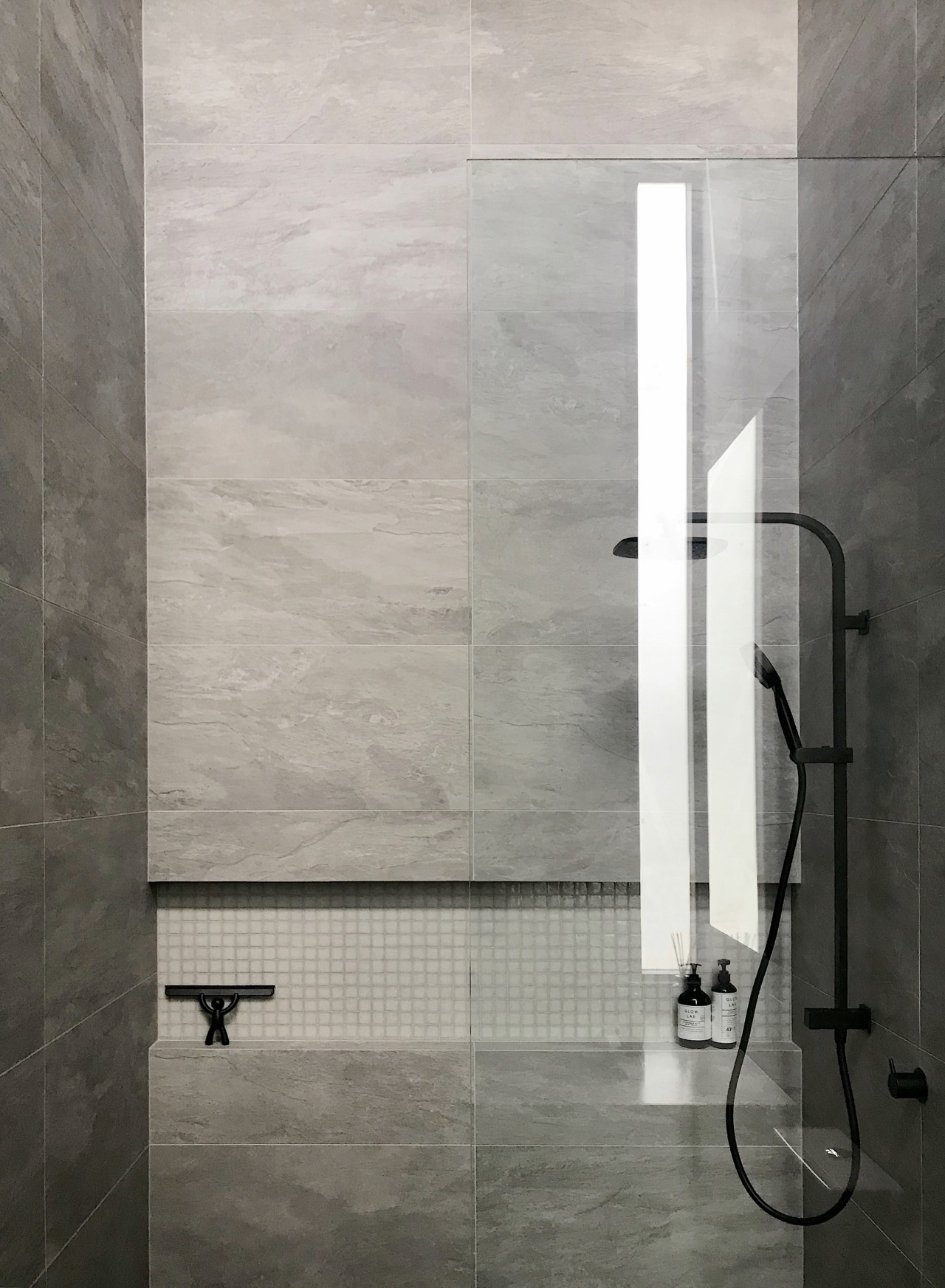 The clean-lined shower in this bathroom includes a
