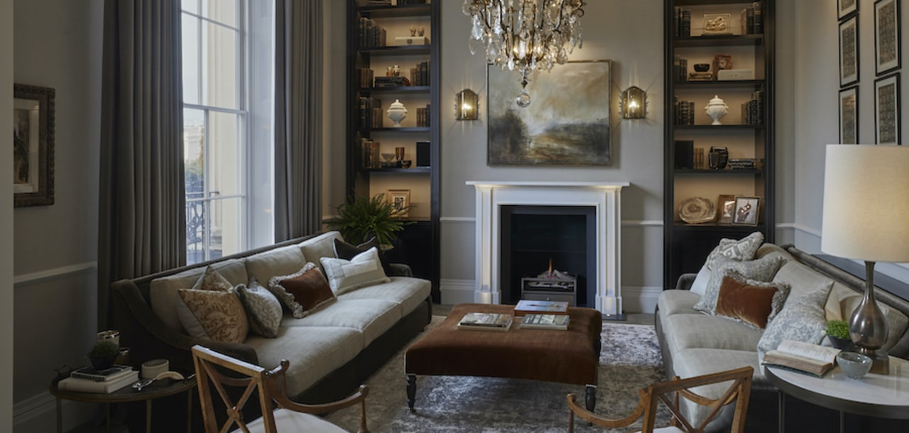 The drawing-room, overlooking the park, offers a warm