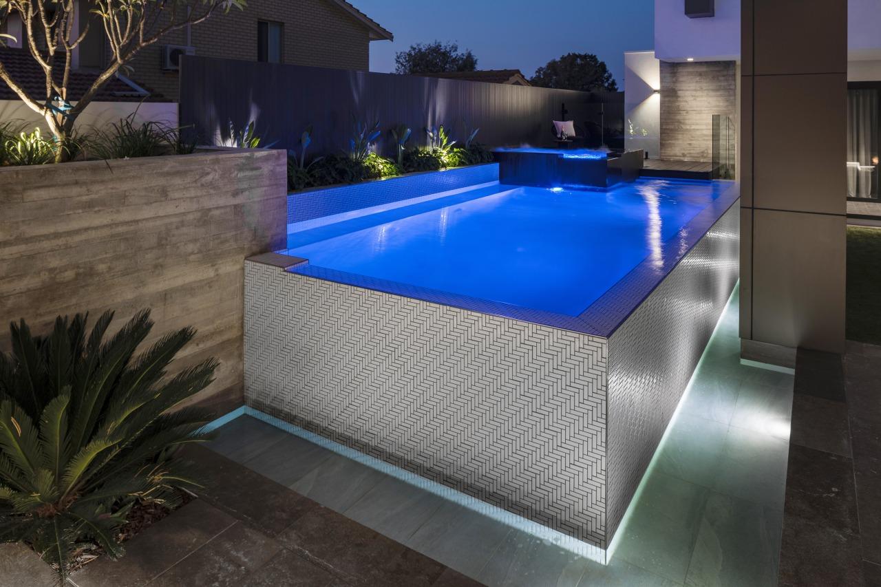Wow! Thanks to adroit lighting, the pool takes