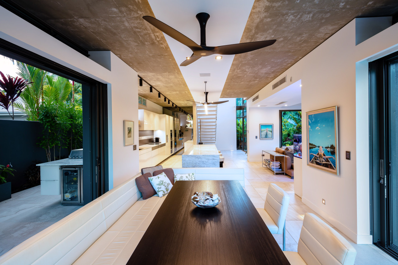 A bench seat saves space and allows for architecture, daylighting, estate, home, house, interior design, living room, real estate, gray