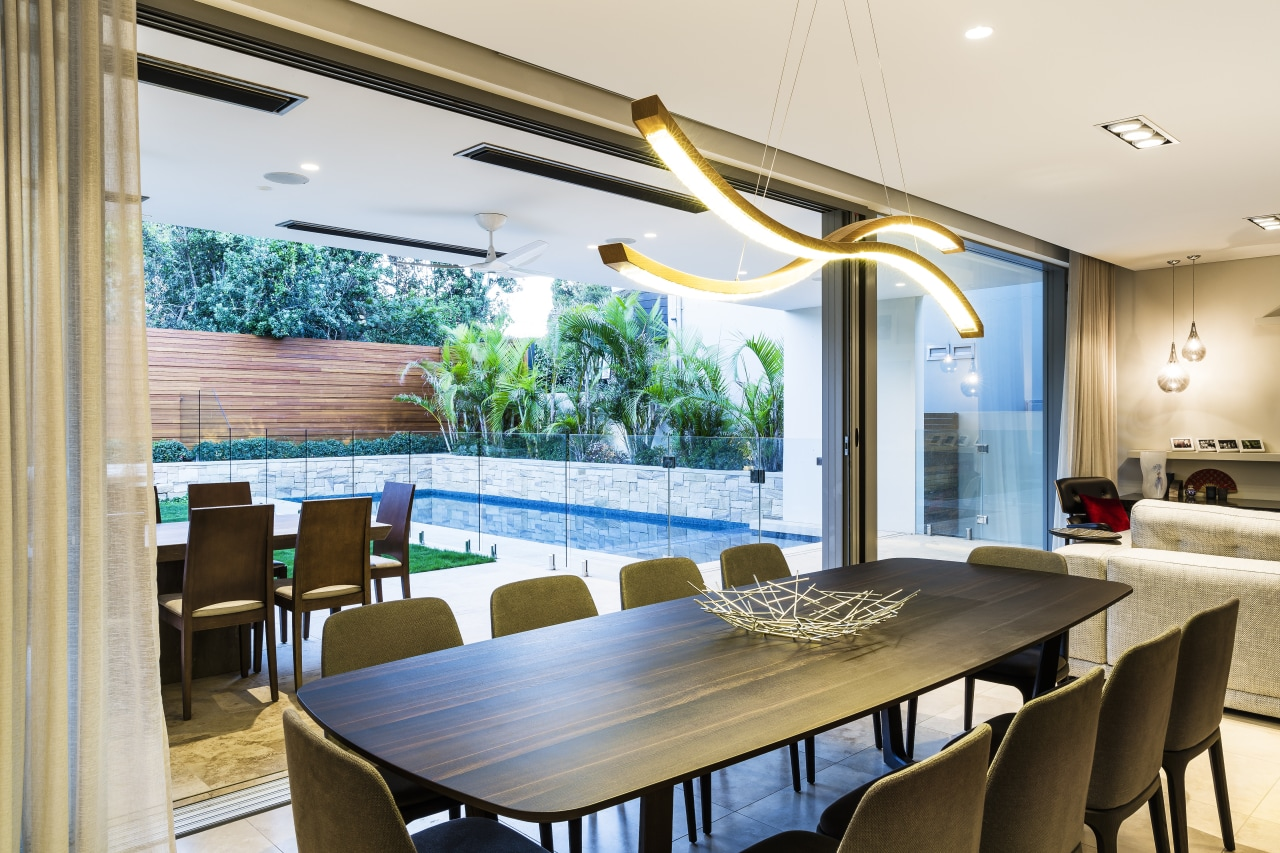 Connected to the combined living, kitchen, dining space dining room, interior design, table, window, indoor outdoor flow, glass sliders, Giles & Tribe