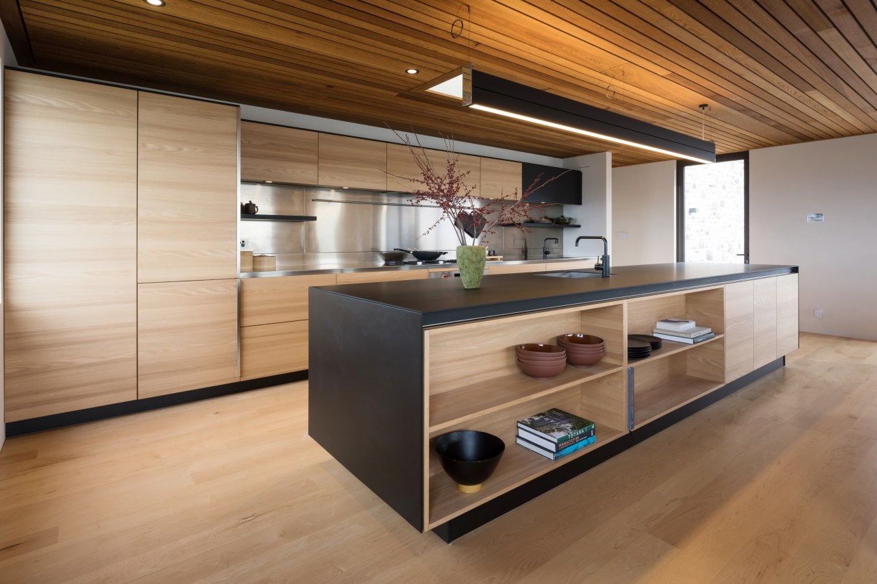 Part of the calm, restful appeal of this architecture, cabinetry, countertop, cuisine classique, floor, flooring, hardwood, house, interior design, kitchen, real estate, wood, wood flooring, brown, open shelving, shelving