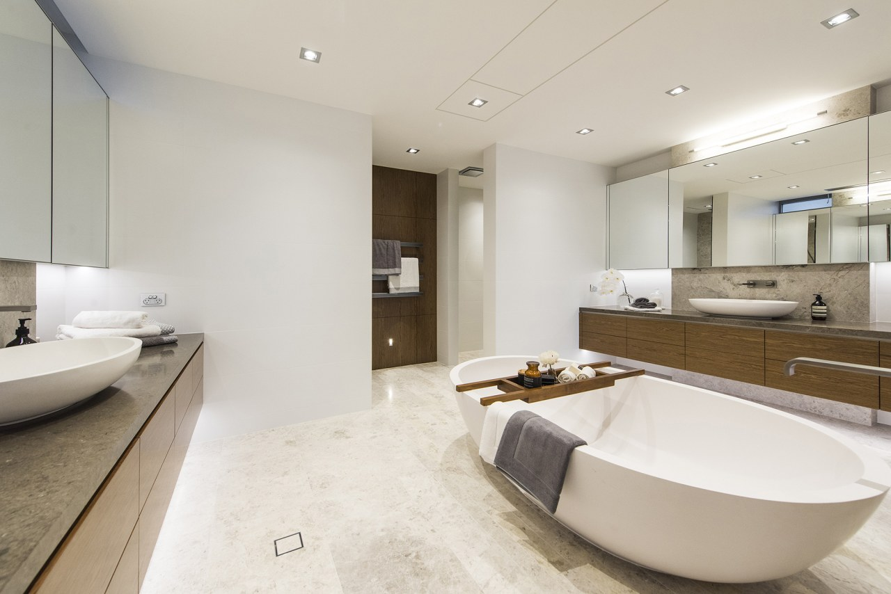 In this master ensuite, oval countertop basins on bathroom, floor, interior design, real estate, room, sink, gray