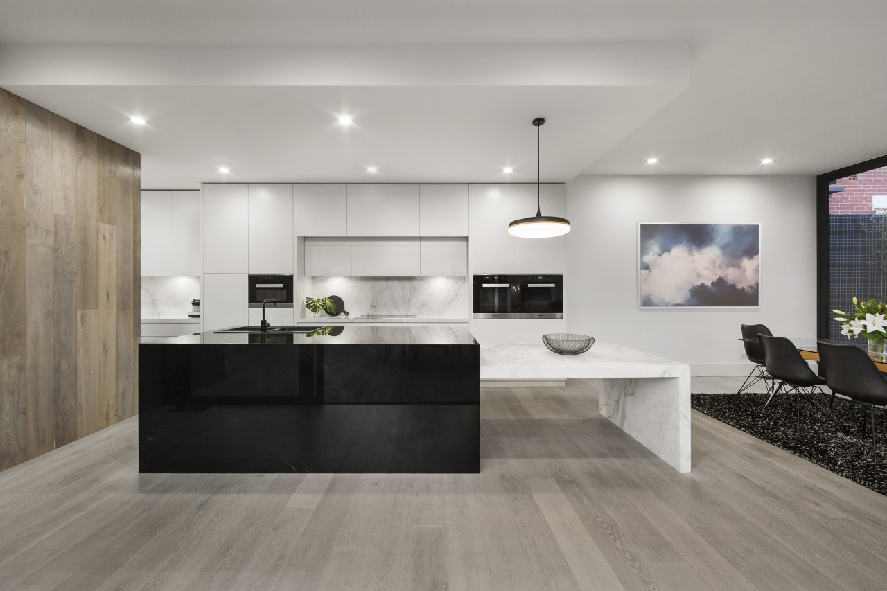 ​​​​​​​While packing a punch in terms of functionality countertop, timber floor, flooring, interior design, kitchen, laminate flooring, tile, wood flooring, black, LSA Architects