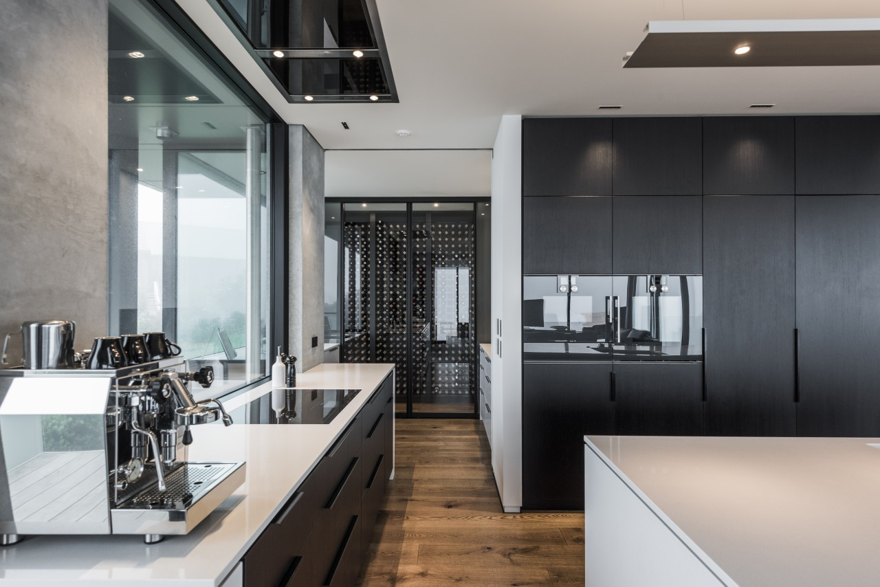 ​​​​​​​To the rear of this kitchen by designer countertop, interior design, kitchen, gray, black