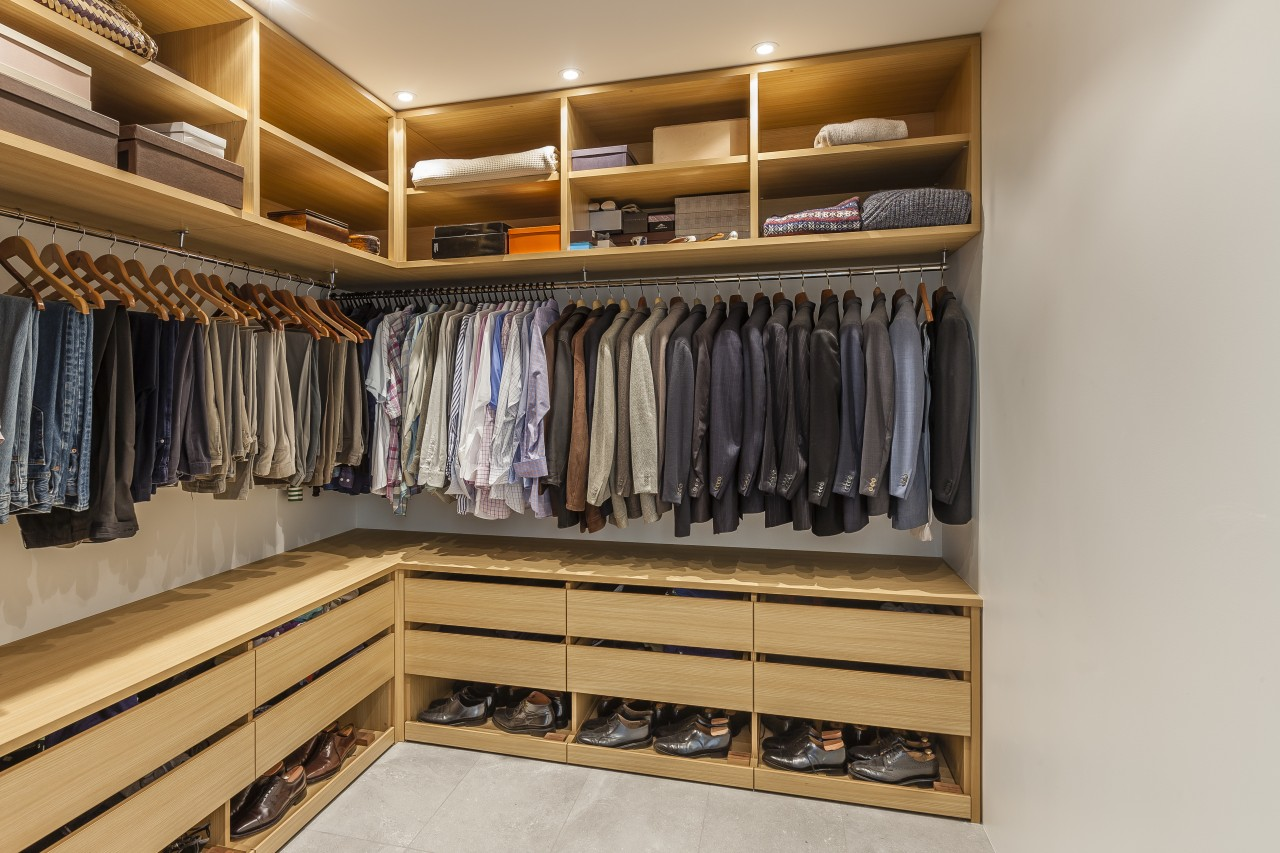 Bespoke, no-space-wasted wardrobe cabinetry ensures maximum style and