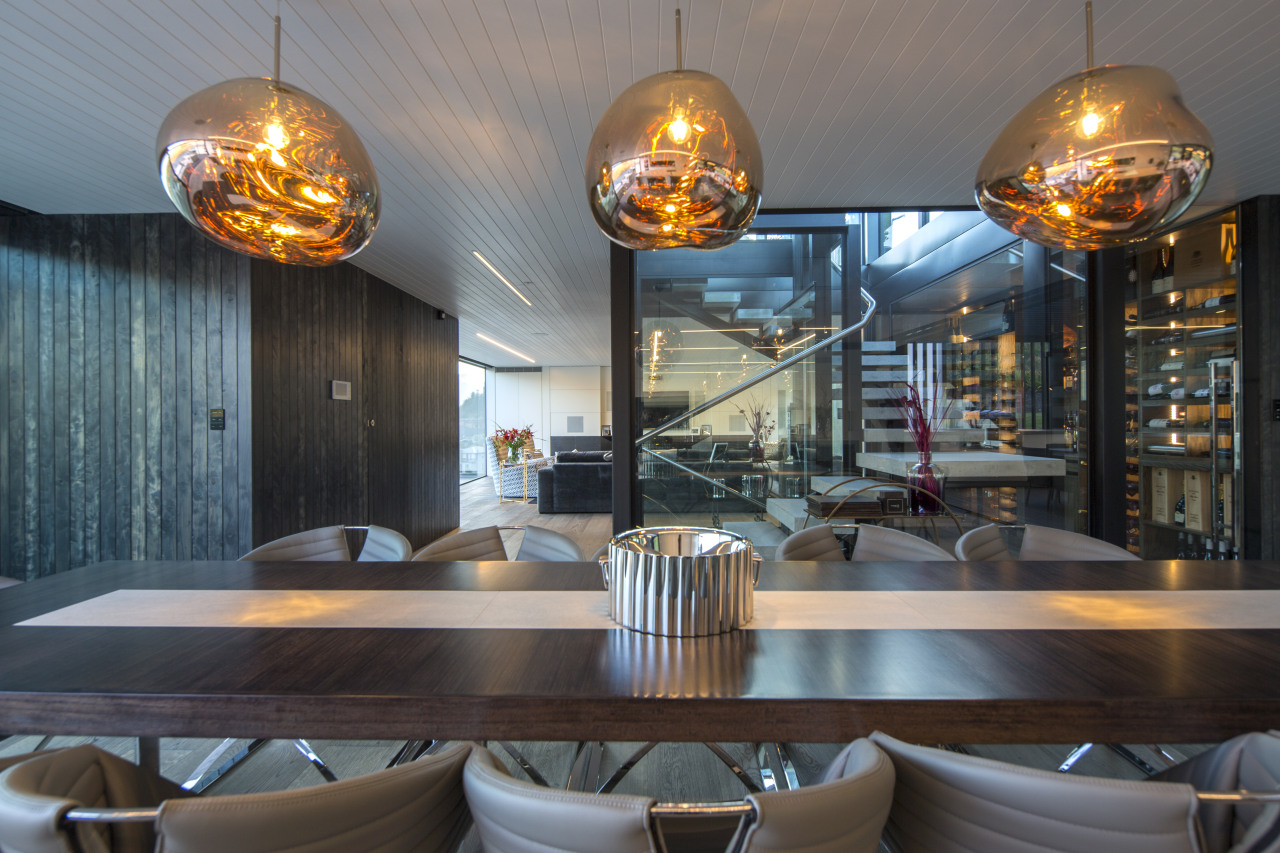 ​​​​​​​Sculptural pendants over the dining table reflect the interior design, pendants, Gary Todd Architecture, kitchen