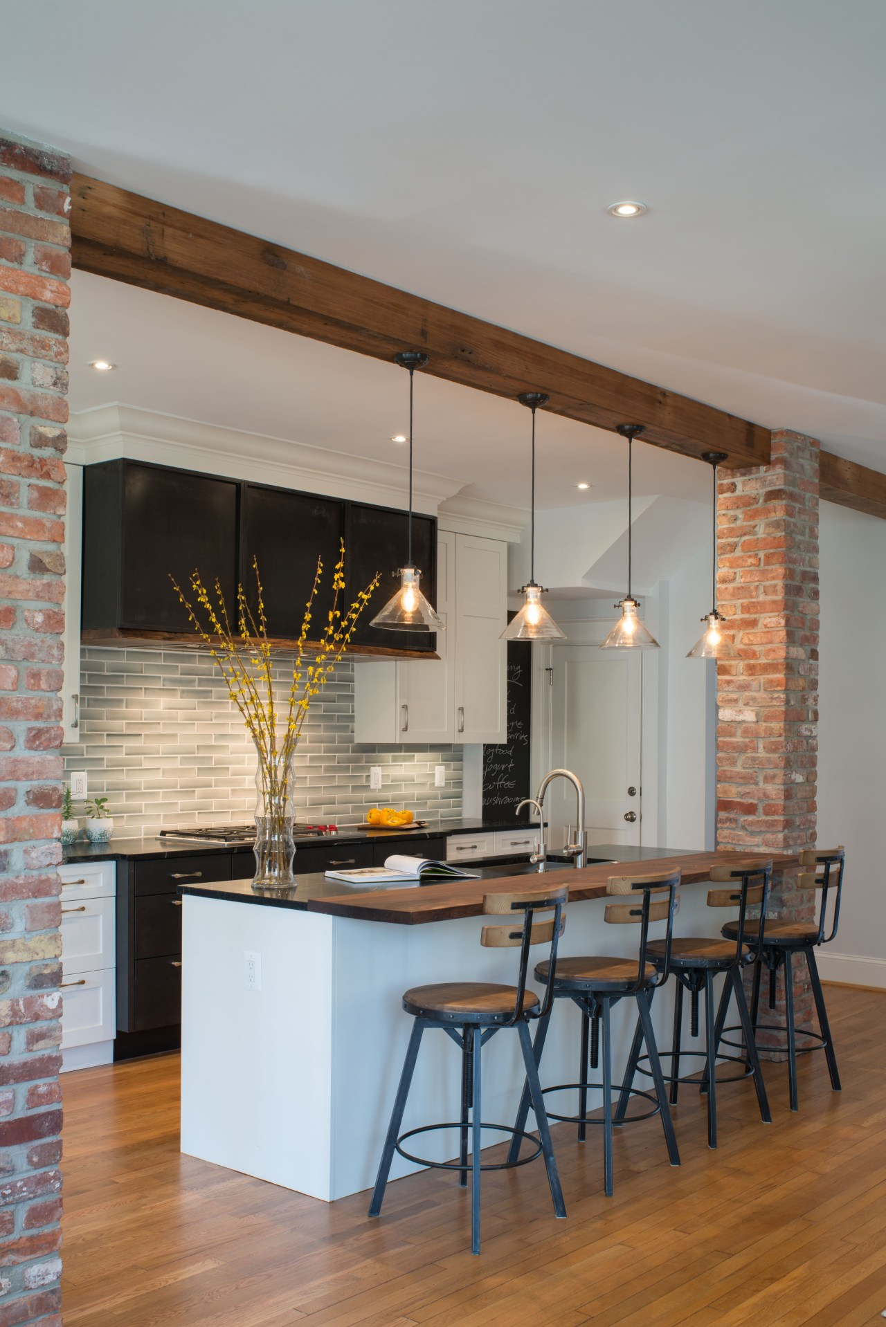 This reinvented kitchen is graced with simplified versions cabinetry, benchtop, dining room, floor, flooring, hardwood, interior design, kitchen, table, wood flooring, lighting, bar stools