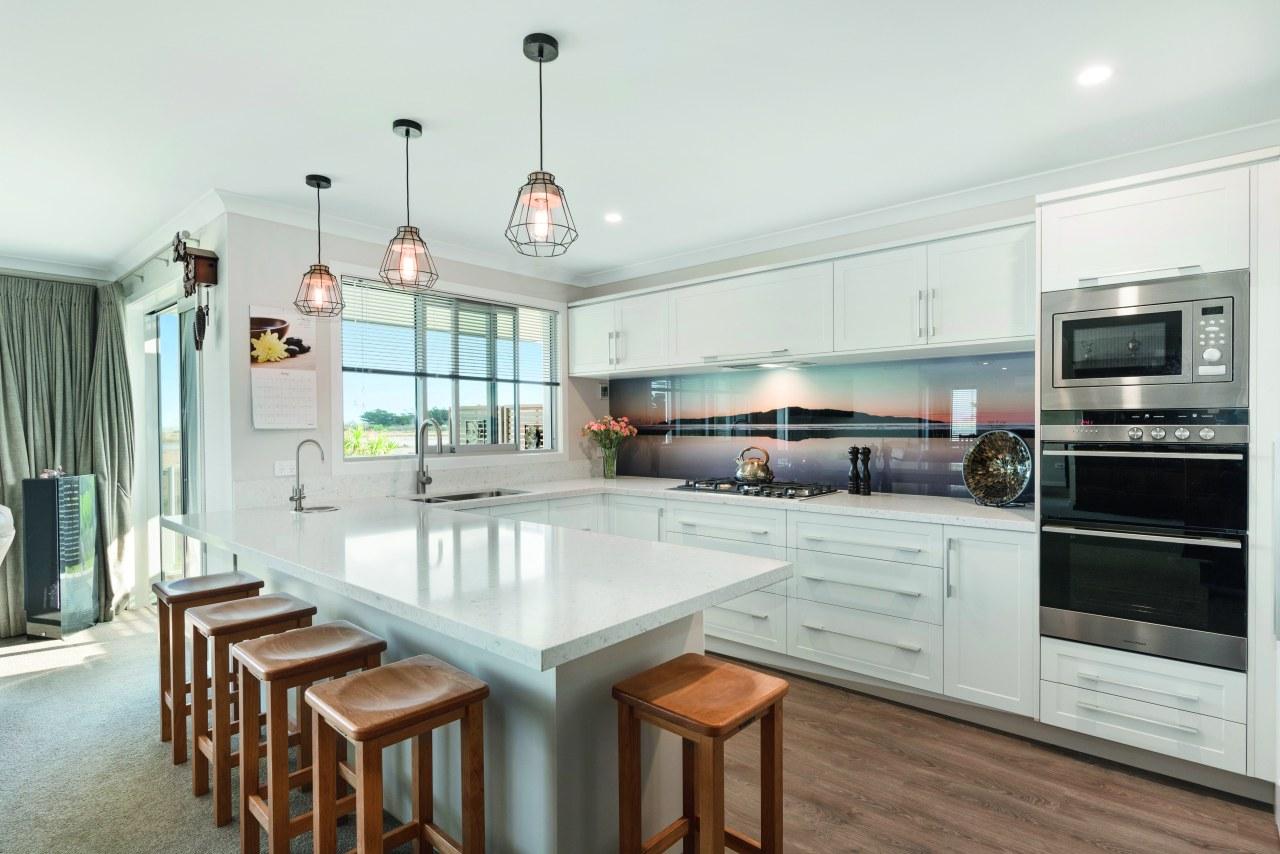 This sleek, modern kitchen boasts a stunning splashback, countertop, interior design, kitchen, white, Fowler Homes,  new home builder, splashback, fisher & paykel, appliances, new home builder