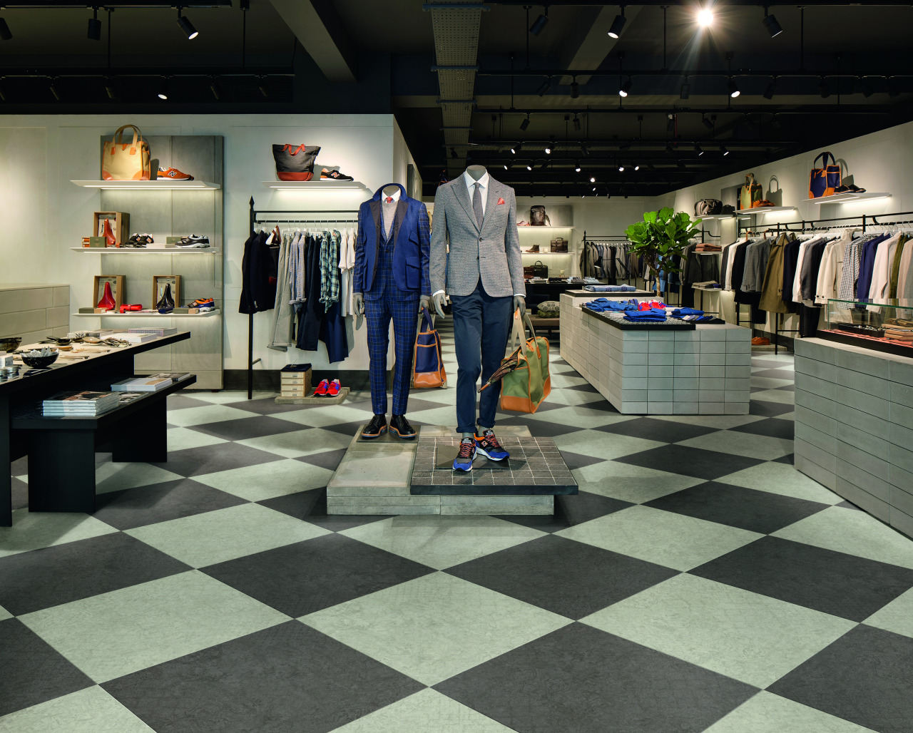 The biggest surface area in the room, retail boutique, floor, flooring, interior design, retail, black, gray