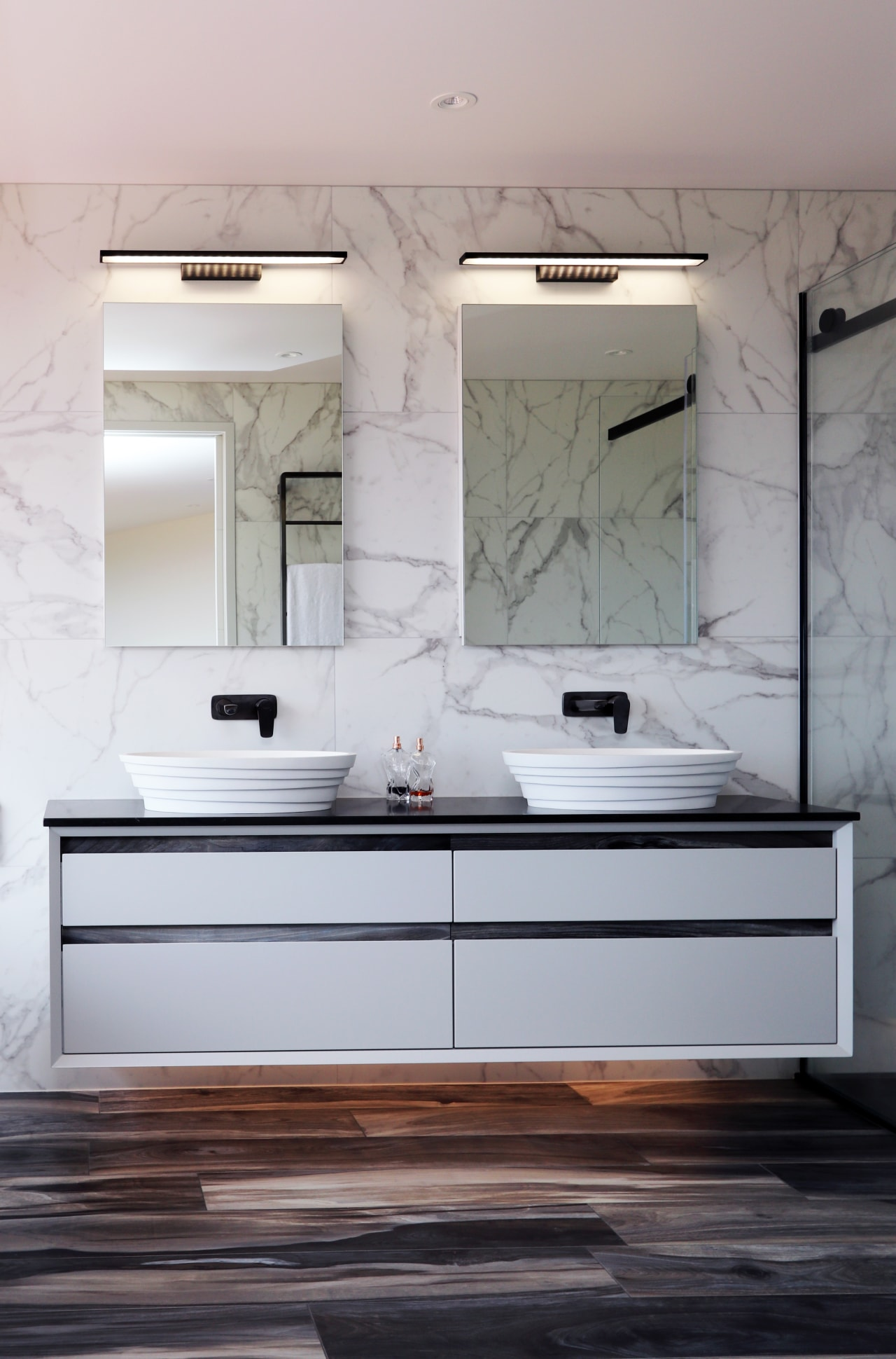 This custom his-and-hers vanity, supplied locally by Elite architecture, bathroom, bathroom accessory, building, cabinetry, ceiling, countertop, floor, flooring, furniture, home, house, interior design, material property, plumbing fixture, property, room, sink, tap, tile, wall, white, gray