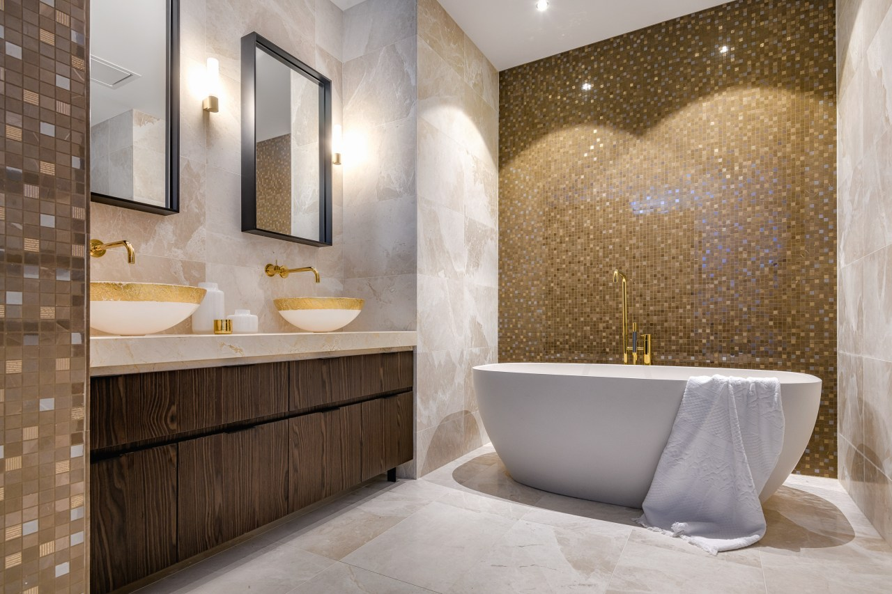 Gold-painted basins and glittering feature walls in this architecture, bathroom, bathtub, floor, flooring, interior design, marble, plumbing fixture, tap, tile, gold painted basins, feature wall, Davinia Sutton