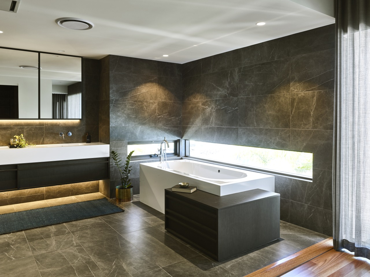 This bathroom has an attractive, balanced lighting scheme architecture, bathroom, bathtub, building, cabinetry, ceiling, countertop, design, floor, flooring, furniture, home, house, interior design, lighting, material property, plumbing fixture, property, room, sink, tap, tile, wall, black, gray