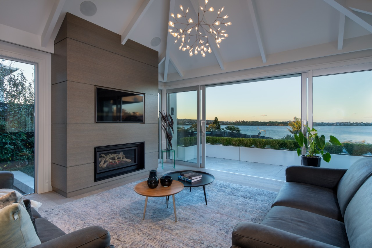 Room-high glass sliders open up this lakeside home