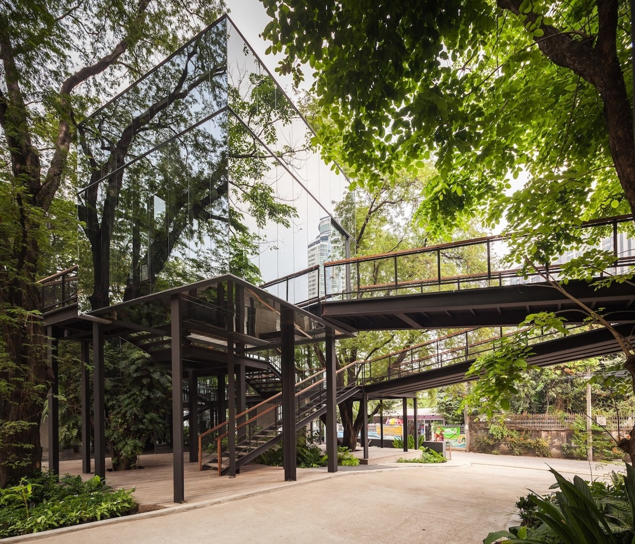 The building seamlessly co-exists with the trees architecture, house, outdoor structure, plant, real estate, skyway, tree, walkway, brown, black