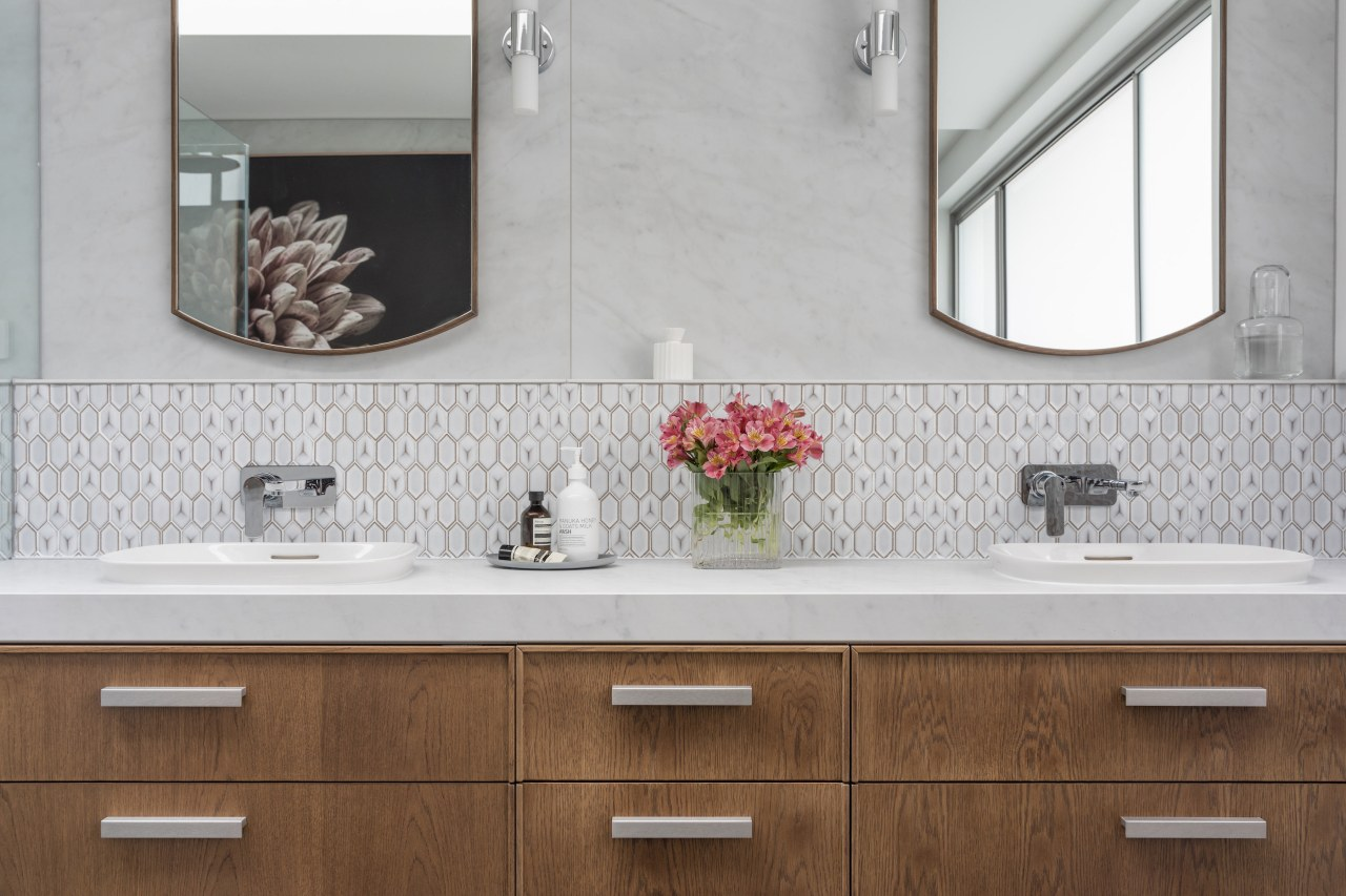 The large custom double vanity complements the timber