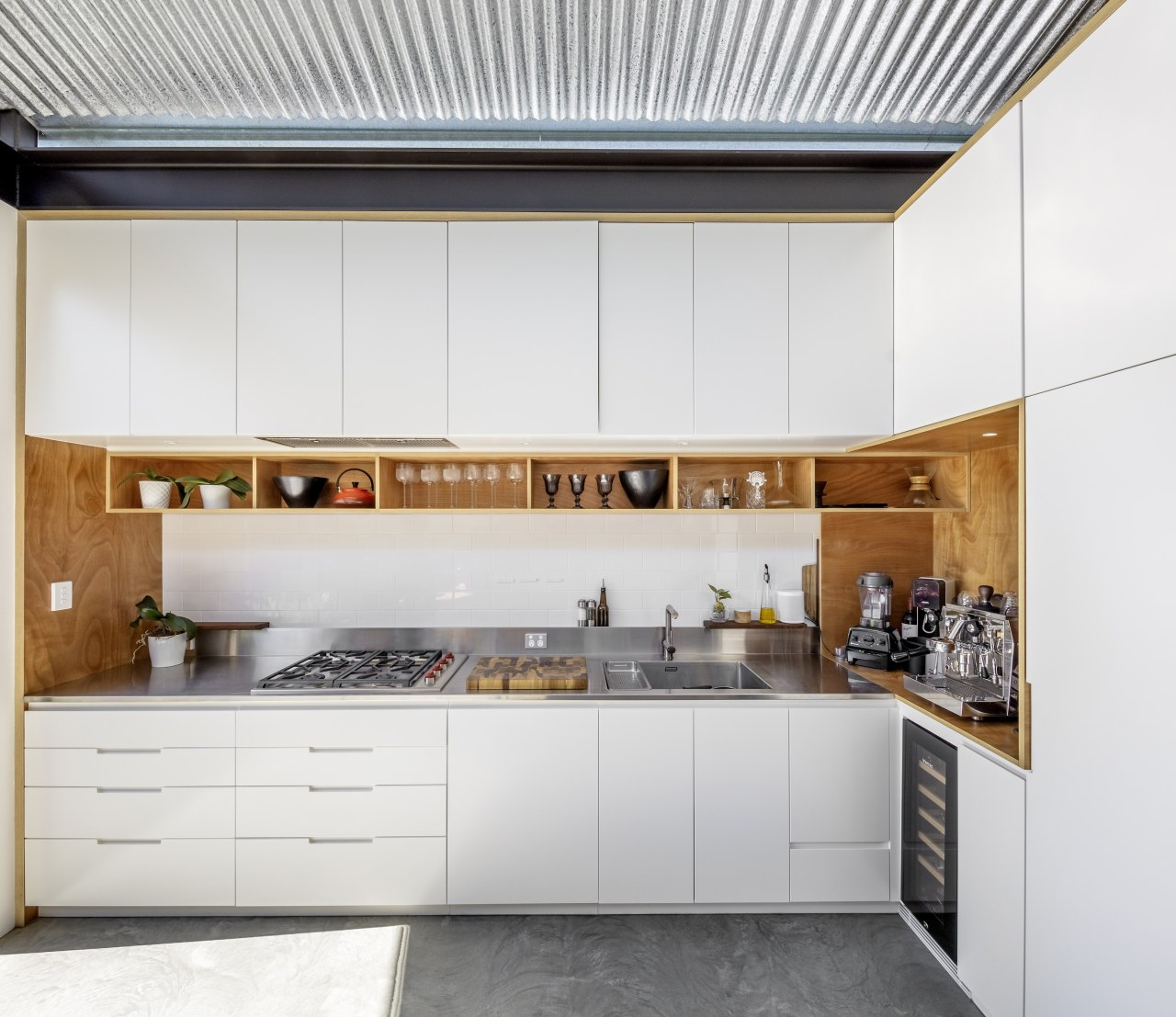 The home's white and wood kitchen.