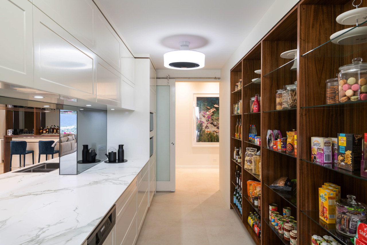 The spacious, well laid out pantry complements the