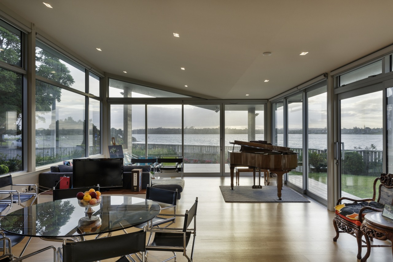 This new home takes advantage of sea views apartment, architecture, building, ceiling, door, estate, facade, floor, flooring, furniture, glass, home, house, interior design, living room, porch, property, real estate, residential area, room, shade, table, window, gray, black