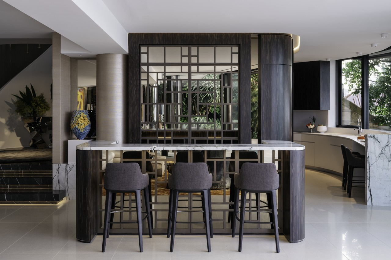 Hand-cut mirrored screens on the bar doors and